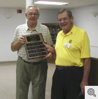Tim Keating, (left) past Men's Club President receiving past president's plaque from current Men's Club President, Bill Patterson.