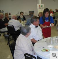 Student Hazel Bonilla takes an order from Bill Patterson, Men's Club President, and his wife Diane.