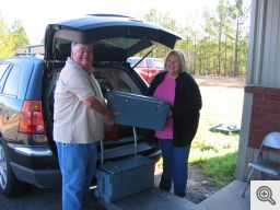 Danny Murphy, Sacred Heart Men's Club Secretary and Meals on Wheels Committee Chairman, and his wife Kathy load up their van at the McCauley Center with meals, bread and milk for delivery.
