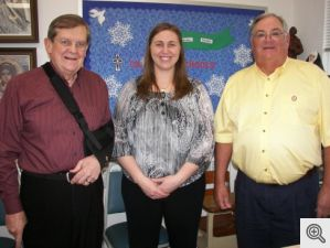 Elizabeth Shackelford, Principal of St. Johns School in Hot Springs received $1000 from Bill Patterson and Danny Murphy on behalf of the Men's Club.