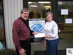 Another $1000 was delivered by Bill Patterson to Jane Mitchell, representative of the Paul Bewie Boys and Girls Club for their general fund.