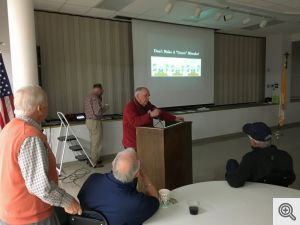 Buddy Dixon making a presentation on the Sacred Heart Cemetery