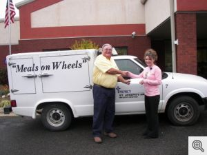 A donation of $1000 was presented by Danny Murphy to Amanda Maness, Site Director at McCauley Center in Hot Springs Village, designated for their Meals On Wheels Program.