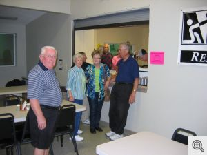 Getting ready to serve the meal at the Samaritan Ministries' facility are (l. to r.) Bob Heisler, Kathleen Nosek, Dick Hill, Janice Spaniel, Marvin Young, Milt Spaniel and Greg Rogers.