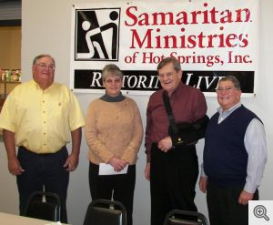 Jan Loggan, Executive Director of Samaritan Ministries in Hot Springs accepted $1000 from Men's Club representatives Danny Murphy, Bill Patterson, and Dick Hill.