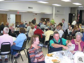 Guests enjoying the fish dinner being served at the Fish Bake.